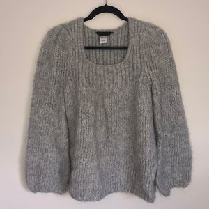 Grey knit sweater. Bell sleeves.